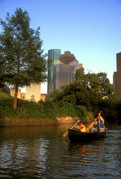 Stock photo of a father and his young daughter canoeing down Buffalo Bayou near downtown Houston.