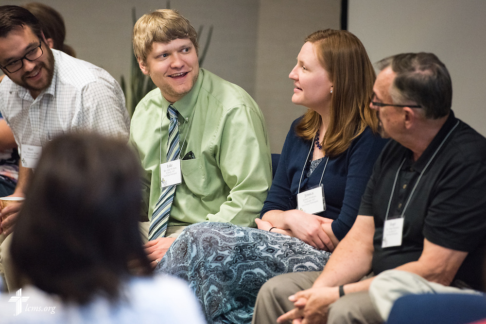 The Rev. Luke Wolters (second from left), pastor at Grace Lutheran Church in Wellsville, Mo., speaks during a panel discussion at the Post Seminary Applied Learning and Support (PALS) Facilitator Training Conference at the International Center of The Lutheran Church–Missouri Synod on Tuesday, August 4, 2015, in Kirkwood, Mo. He is joined by Jessica Wolters, the Rev. Matt Wood (far left), pastor of Concordia Lutheran Church in Maplewood, Mo., and the Rev. Roger Sassaman, pastor of Peace Lutheran Church in Owensboro, Ky. LCMS Communications/Erik M. Lunsford