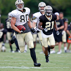 July 28, 2012; Metairie, LA, USA; New Orleans Saints tight end Jimmy Graham (80) runs past cornerback Patrick Robinson (21) during a training camp practice at the team's practice facility. Mandatory Credit: Derick E. Hingle-US PRESSWIRE