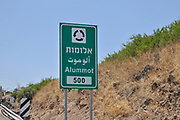Israel, Galilee a road sign in English, Arabic and Hebrew directing to Alummot