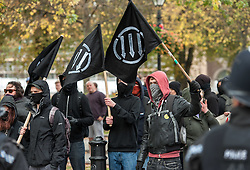 © Licensed to London News Pictures. 17/10/2015. Bristol, UK.  Anti-Fascists.  Bristol Patriots vs Anti-Fascists twin demonstrations in Bristol city centre.  The Bristol Patriots were marching against 'Somali rape gangs' and immigration, and the Anti-Fascists opposed them.  Violence flared between Anti-Fascists and police who made several arrests.  Photo credit : Simon Chapman/LNP
