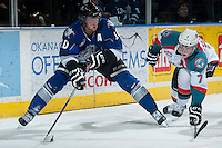 KELOWNA, CANADA -FEBRUARY 8: Damon Severson #7 of the Kelowna Rockets stick checks Ben Walker #10 of the Victoria Royals as he skates behind the net with the puck during second period on February 8, 2014 at Prospera Place in Kelowna, British Columbia, Canada.   (Photo by Marissa Baecker/Getty Images)  *** Local Caption *** Damon Severson; Ben Walker;