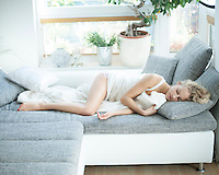 Young woman sleeping on sofa at home