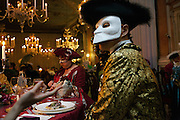 Tourists dressed in traditional costume attend the Ballo Tiepolo in the Pisani Moretta palace in Venice during the carnival.