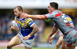Leeds Rhinos' Luke Briscoe is tackled by Catalans Dragons' Tony Gigot, during the Betfred Super League match at Emerald Headingley Stadium, Leeds.