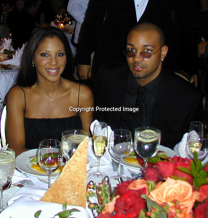 Toni Braxton and Boyfriend<br />Arista Records Pre Grammy Bash Hosted By Clive Davis<br />Beverly Hills Hotel<br />Los Angeles, California, USA<br />Tuesday,February 22, 2000<br />Photo By Celebrityvibe.com/Photovibe.com