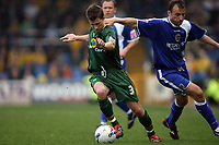 Norwich City captain Adam Drury breaks out of defence