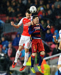 Arsenal's Laurent Koscielny challenges Lionel Messi of Barcelona  - Mandatory byline: Matt McNulty/JMP - 16/03/2016 - FOOTBALL - Nou Camp - Barcelona,  - FC Barcelona v Arsenal - Champions League - Round of 16