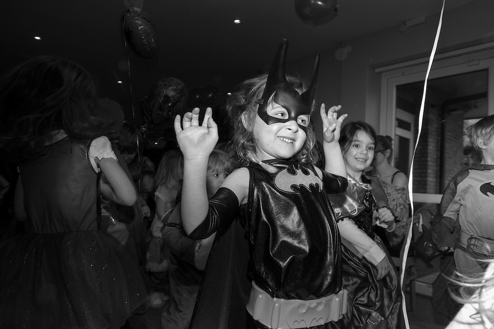 Aisling as Batgirls takes part in the disco dance section of a fancy dress party game at the Tennis club in Berkhamsted in England Saturday, Feb. 14, 2015 (Elizabeth Dalziel) #thesecretlifeofmothers #bringinguptheboys #dailylife