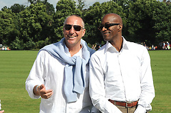 Left to right, SIR IAN BOTHAM and EDWIN MOSES at the IWC Laureus Polo Cup Day 2008 held at Ham Polo Club, Surrey on 22nd June 2008.<br /><br />NON EXCLUSIVE - WORLD RIGHTS