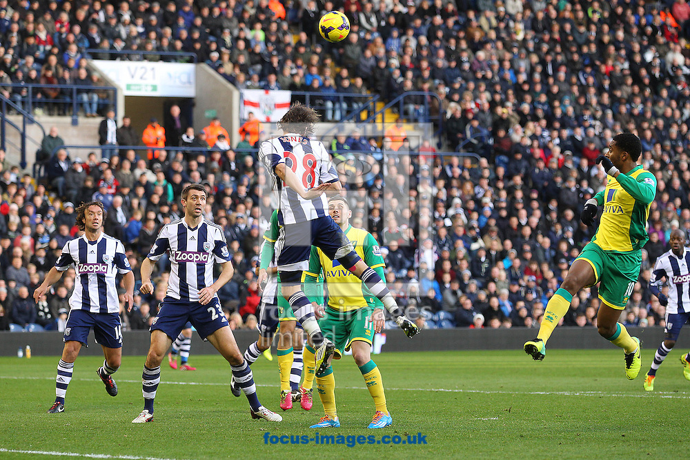 Picture by Paul Chesterton/Focus Images Ltd +44 7904 640267<br /> 07/12/2013<br /> Billy Jones of West Brom heads clear during the Barclays Premier League match at The Hawthorns, West Bromwich.