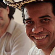 Alberto Lopez, left, and Eduardo Martinez, right, musicians and musical scholars both originally from Colombia, pose for a portrait while playing traditional Afro-Colombian instruments. The photo was taken in Los Angeles, California  on August 31, 2009. Photo by Jen Klewitz