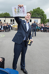 © Licensed to London News Pictures . 03/07/2014 . Leeds , UK . The Deputy Prime Minister , NICK CLEGG MP , at Ireland Wood Primary School in Leeds today (Thursday 3rd July 2014) shows a gift he received from students . The Liberal Democrat leader and MP for Sheffield Hallam watches a Grand Depart school event with children taking part in cycling time trials and singing the the Tour de France anthem . Photo credit : Joel Goodman/LNP