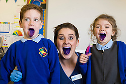 Oasis Lead Dental Nurse Mel Brown with Jacob and Margot after using the disclosure tablets to reveal plaque in the mouth during an oral hygiene session at  Hunloke Park Primary School Wingerworth Chesterfield on Tuesday<br /> 20 October 2015<br />  Image © Paul David Drabble <br />  www.pau ldaviddrabble.co.uk