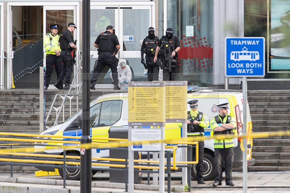 © Licensed to London News Pictures. 11/10/2019. Manchester, UK. Armed police and forensic scenes of crime examiners respond at the scene . Terrorism Police are investigating after four people were stabbed during a single attack at the Arndale Centre in Manchester City Centre . Photo credit: Joel Goodman/LNP
