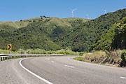State highway 3 sweeps below wind turbines in the Manawatu, North Island, New Zealand