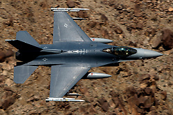 United States Air Force General Dynamics F-16C Fighting Falcon (88-0512) from the South Dakota Air National Guard flies low level through the Jedi Transition, Star Wars Canyon, Death Valley National Park, California, United States of America