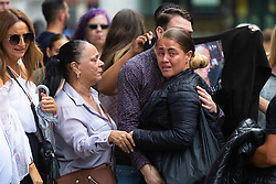 family and friends of Charlotte Huggins celebrate outside the Old Bailey in London following the guilty verdict of Michael Rolle, 34, of stabbing mother-of-one, 33, at her home in Kennington. He will be sentenced tomorrow (19 July). London, July 18 2019.