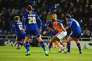 Uche Ikpeazu of Blackpool FC (On loan from Watford FC) battles through a crowd of Oldham defenders during the Sky Bet League 1 match between Oldham Athletic and Blackpool at SportsDirect.Com Park, Oldham, England on 15 March 2016. Photo by Mike Sheridan.