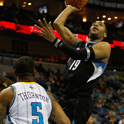February 7, 2011; New Orleans, LA, USA; Minnesota Timberwolves guard Wayne Ellington (19) shoots over New Orleans Hornets guard Marcus Thornton (5) during the fourth quarter at the New Orleans Arena. The Timberwolves defeated the Hornets 104-92.  Mandatory Credit: Derick E. Hingle