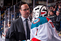 KELOWNA, CANADA - MARCH 7: Assistant coach Kris Mallette stands on the bench and speaks to James Porter #1 of the Kelowna Rockets against the Vancouver Giants  on March 7, 2018 at Prospera Place in Kelowna, British Columbia, Canada.  (Photo by Marissa Baecker/Shoot the Breeze)  *** Local Caption ***