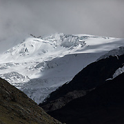 Snow-capped Andean mountains, seen from the Interoceanica Sur highway between Cusco and Puerto Maldonado, Peru. A 430 kilometer section of the transcontinental Interoceanic Highway that crosses Peru and Brazil.