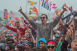 Catfish and the Bottlemen stat playing in and even the arriving rain cannot dampen the enthusiasm of their fans.  The 2015 Glastonbury Festival, Worthy Farm, Glastonbury.
