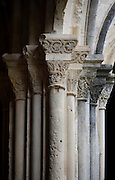 Detail of pillars and capitals in the cloister of Monestir de Poblet, 1151, Vimbodi, Catalonia, Spain, pictured on May 20, 2006, in the afternoon. The Monastery of Poblet belongs to the Cistercian Order and was founded by French monks. Originally, Cistercian architecture, like the rules of the order, was frugal. But continuous additions  including late Gothic and Baroque, eventually made Poblet one of the largest monasteries in Spain which was later used as a fortress and royal palace. It was closed in 1835 by the Spanish State but refounded in 1940 by Italian Cistercians. It is a UNESCO World Heritage Site. Picture by Manuel Cohen.