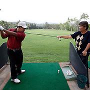 HONOLULU, HAWAII, November 8, 2007: Tadd Fujikawa, a sixteen-year-old professional golfer, practices at the Honolulu Country Club in Honolulu, Hawaii . (Photographs by Todd Bigelow/Aurora)