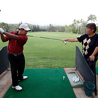 HONOLULU, HAWAII, November 8, 2007: Tadd Fujikawa, a sixteen-year-old professional golfer, practices at the Honolulu Country Club in Honolulu, Hawaii . (Photographs by Todd Bigelow/Aurora)
