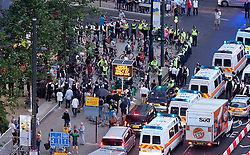 © Licensed to London News Pictures. 27/07/2012. LONDON, UK. Critical Mass cycling protesters are seen being blocked by police as they demonstrate in Stratford near the Olympic Stadium during the opening ceremony of the 2012 Summer Olympics. Constituting the third time the Olympic Games have been held in Great Britain, the 2012 Olympic Games, also known as the Games of the XXX Olympiad opened this evening with a show, put together by 'Slum Dog Millionaire' director Danny Boyle, entitled 'The Isles of Wonder. Photo credit: Matt Cetti-Roberts/LNP