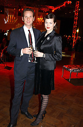 Model JASMINE GUINNESS and GAWAIN RAINEY at a party to celebrate the global launch of the Moet & Chandon Vintage 1999 hell at Lawrence Hall, Royal Horticultural Hall, London SW1 on 22nd March 2005.<br /><br />NON EXCLUSIVE - WORLD RIGHTS