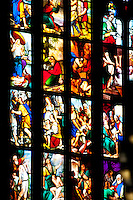 Milan, Italy, Duomo Cathedral. Stained glass window. Multi panes depicting a biblical story.