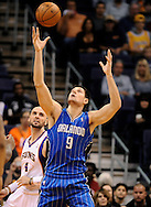 Dec. 09, 2012; Phoenix, AZ, USA; Orlando Magic center Nikola Vucevic (9) looks up to catch the ball during the game against the Phoenix Suns center Marcin Gortat (4) in the first half at US Airways Center.  Mandatory Credit: Jennifer Stewart-USA TODAY Sports.