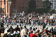 Violent clashes between pro and anti Mubarak in Tahrir Square.<br /> After an agressive incursion in Tahrir Square, the repelled  Mubarak's supporters throw back rocks at anti Egyptian president demonstrators. 02 February 2011.