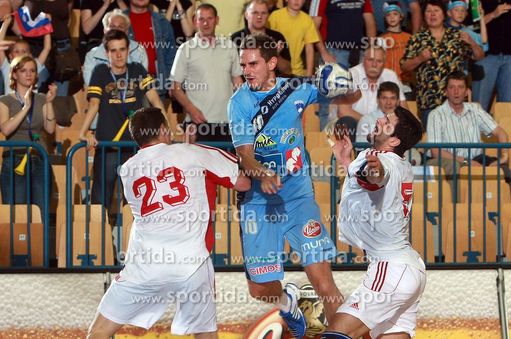 Bostjan Kavas of Slovenia between Radoslav Antl and Frantisek Sulc of Slovakia at  handball game between men national teams of Slovenia and Slovakia, first qualification game for the World Chamionship 2009, on June 7, 2008, in Arena Zlatorog, Celje, Slovenija. Result: 33 : 33. (Photo by Vid Ponikvar / Sportal Images)
