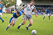 Colchester United defender Tom Eastman tackled by Macclesfield Town midfielder Connor Kirby during the EFL Sky Bet League 2 match between Macclesfield Town and Colchester United at Moss Rose, Macclesfield, United Kingdom on 28 September 2019.