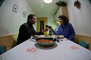 Italy, The Dolomites, San Andreas Agroturismo hostel a visiting couple enjoying a self cooked meal Model Releases Available