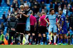 Vincent Kompany of Manchester City hugs Kasper Schmeichel of Leicester City at full time - Mandatory by-line: Matt McNulty/JMP - 13/05/2017 - FOOTBALL - Etihad Stadium - Manchester, England - Manchester City v Leicester City - Premier League