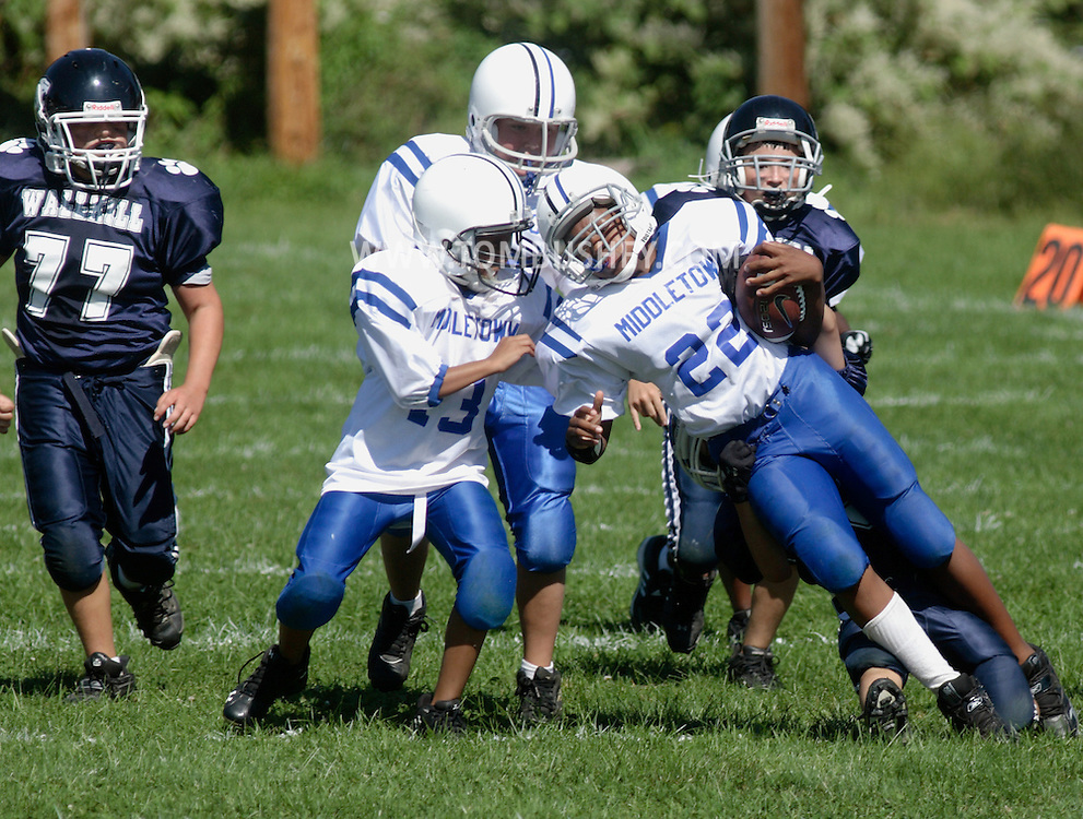 Middletown, NY - A Middletown player carries the ball during an Orange County Youth Football League game at Watts Park on Sept. 2, 2007.