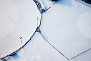 Nederland, Noord-Holland, Hilversum, 07-01-2010; abstract winterlandschap met  sneeuw, geometrie van sintelbaan en hekken.abstract winter landscape with snow, geometry of fences and track.luchtfoto (toeslag), aerial photo (additional fee required).foto/photo Siebe Swart