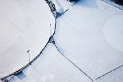 Nederland, Noord-Holland, Hilversum, 07-01-2010; abstract winterlandschap met  sneeuw, geometrie van sintelbaan en hekken.abstract winter landscape with snow, geometry of fences and track.luchtfoto (toeslag), aerial photo (additional fee required).foto/photo Siebe Swart
