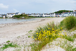 View of beach and whitewashed houses at Port Ellen on Islay in Inner Hebrides , Scotland, UK