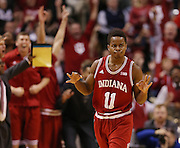 Hoosier Kevin Yogi Ferrell celebrates a big three pointer in the closing minutes against Butler to lead his team to a win. Indiana and Butler faced off in the first game of the Crossroads Classic at Bankers Life Fieldhouse Saturday, December 20, 2014.