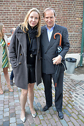 SIMON DE PURY and MICHAELA NEUMEISTER at a private view in aid of Chickenshed of Julian Schnabel's first UK solo show of paintings for 15 years entitled 'Every Angel Has A Dark Side' held at the Dairy Art Centre, 7a Wakefield Street, Bloomsbury, London on 24th April 2014.