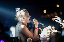 © Licensed to London News Pictures. 06/09/2014. Isle of Wight, UK. MO performing live at Bestival 2014 Day 3 Saturday.  MO is the stage name of Karen Marie Orsted.  This weekend's headliners include Chic featuring Nile Rodgers, Foals and Outcast.   Bestival is a four-day music festival held at the Robin Hill country park on the Isle of Wight, England. It has been held annually in late summer since 2004.    Photo credit : Richard Isaac/LNP