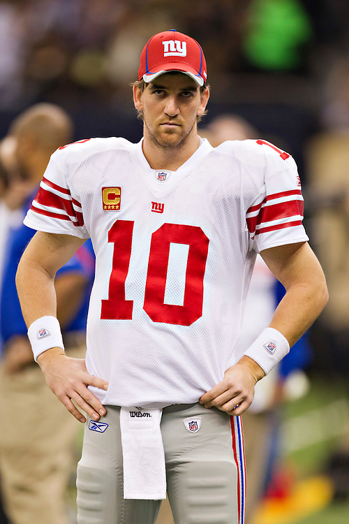 NEW ORLEANS, LA - NOVEMBER 28:   Eli Manning #10 of the New York Giants on the sidelines during a game against the New Orleans Saints at Mercedes-Benz Superdome on November 28, 2011 in New Orleans, Louisiana.  The Saints defeated the Giants 49-24.  (Photo by Wesley Hitt/Getty Images) *** Local Caption *** Eli Manning