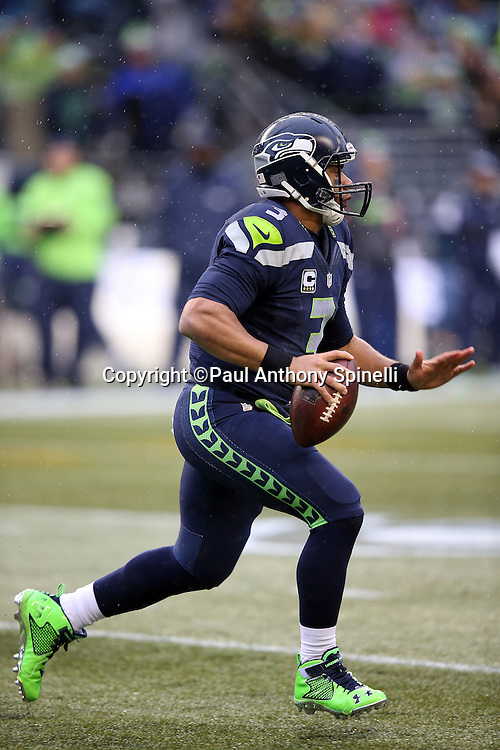 Seattle Seahawks quarterback Russell Wilson (3) scrambles away from second quarter pressure during the 2015 NFL week 16 regular season football game against the St. Louis Rams on Sunday, Dec. 27, 2015 in Seattle. The Rams won the game 23-17. (©Paul Anthony Spinelli)