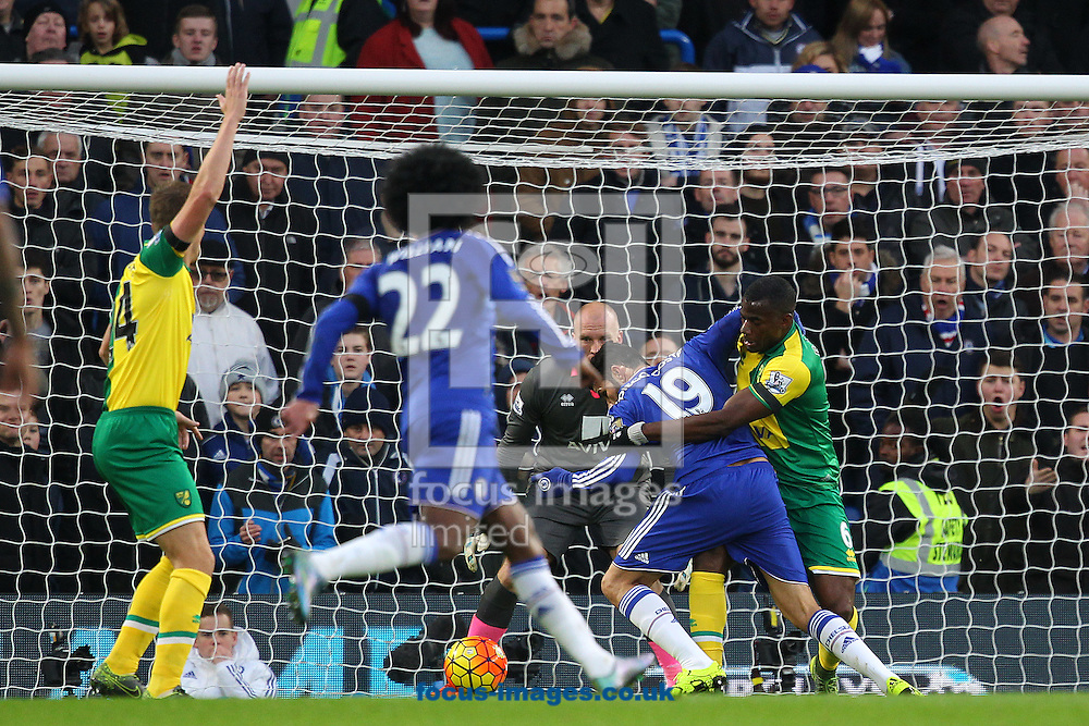 Diego Costa of Chelsea is fouled by Sebastien Bassong of Norwich in the area but no penalty is awarded by Referee Craig Pawson during the Barclays Premier League match at Stamford Bridge, London<br /> Picture by Paul Chesterton/Focus Images Ltd +44 7904 640267<br /> 21/11/2015