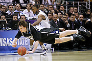 Butler's Matt Howard keeps the ball inbound with Kansas State's Jacob Pullen in pursuit during the second half of the NCAA West Regional final college basketball game in Salt Lake City, Saturday, March 27, 2010. (AP Photo/Colin E. Braley).